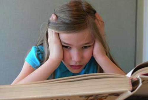 Dyslexic child having difficulty reading