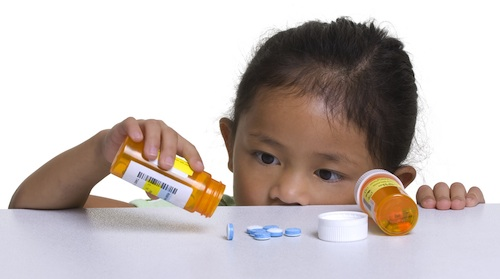 Young girl pouring pills
